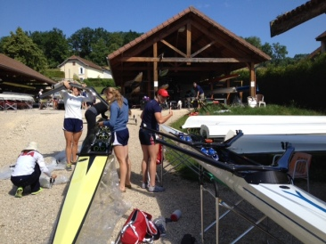 Rigging the boats for training at Aviron du Lac Bleu in Paladru, France.